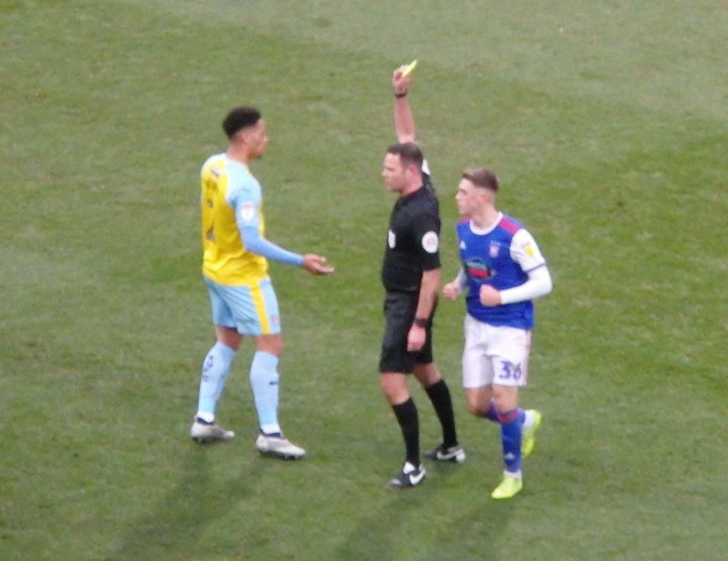 insipid kit and a yellow card